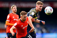 17th October 2020; Kenilworth Road, Luton, Bedfordshire, England; English Football League Championship Football, Luton Town versus Stoke City; Nathan Collins of Stoke City competes for the ball with Jordan Clark of Luton Town