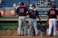 Lowell Spinners Nick Decker (right) congratulates Wil Dalton (18) after a home run during a NY-Penn League game against the Batavia Muckdogs on July 10, 2019 at Dwyer Stadium in Batavia, New York.  Batavia defeated Lowell 8-6.  (Mike Janes/Four Seam Images)