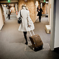 An employee of the European Parliament arriving for a plenary session. Every month thousands of the parliament's employees travel back and forth between the three sites of government in Brussels, Strasbourg and Luxembourg.