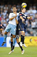 MELBOURNE, AUSTRALIA - FEBRUARY 18, 2010: Leigh Broxham from Melbourne Victory competes for the ball against John Aloisi of Sydney FC in the first leg of the A-League Major Semi Final match between the Melbourne Victory and Sydney FC at Etihad Stadium on February 18, 2010 in Melbourne, Australia. Photo Sydney Low www.syd-low.com