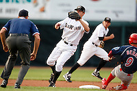 August 1, 2009:  Second Baseman Danny Worth  of the Erie Seawolves takes the throw from catcher as Quinin Berry slides in and Cale Iorg backs up during a game at Jerry Uht Park in Erie, PA.  Erie is the Eastern League Double-A affiliate of the Detroit Tigers.  Photo By Mike Janes/Four Seam Images