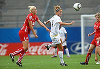 USA's Kristie Mewis (R) and Rahel Kiwic of Switzerland during the FIFA U20 Women's World Cup at the Rudolf Harbig Stadium in Dresden, Germany on July 17th, 2010.