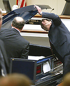 Defense attorneys Jonathan Shapiro, right, and Peter Greenspun inspect a model of a Chevrolet Caprice that sniper suspect John Allen Muhammad was captured in during court proceedings in Virginia Beach Circuit Court in Virginia Beach, Virginia, November 6, 2003. <br /> Credit: Tracy Woodward - Pool via CNP