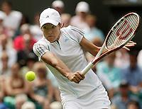 27-6-06,England, London, Wimbledon, first round match,  Justine Henin-Hardenne