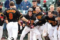 Rochester Red Wings players Chase Lambin #2, Jim Hoey #22, Matt Brown #11, and Ben Revere #5 celebrate a walk off home run by Rene Tosoni #9 during the first game of a double header against the Lehigh Valley Ironpigs at Frontier Field on April 14, 2011 in Rochester, New York.  Rochester defeated Lehigh Valley 3-1 with a walk off home run in the bottom of the seventh.  Photo By Mike Janes/Four Seam Images