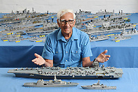 BNPS.co.uk (01202) 558833<br /> Pic: ZacharyCulpin/BNPS<br /> <br /> Pictured: Philip Warren with his brand new models of the Gerald Ford US aircraft carrier (at the back centre), HMS Glasgow (left) and HMS Trent (right).<br /> <br /> A master modeller who was inundated with hundreds of rare matchboxes after appealing for donations has used them to build a 3ft long aircraft carrier.<br /> <br /> Now Philip Warren has added the impressive model to his so-called matchbox fleet of miniature ships which have gone on display in an exhibition.<br /> <br /> Mr Warren's 72 year pastime of building model warships had looked as though it had come to an end earlier this year when he ran out of the traditional wooden boxes he used to make the hull and decks.<br /> <br /> But the 90-year-old was sent more than 300 of the lightweight matchboxes made from aspen wood in response to his plea for more.