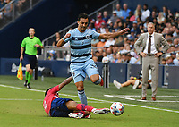 KANSAS CITY, KS - JULY 31: Luis Martins #36 of Sporting Kansas City drives up the left wing as Jesus Ferreira #9 of FC Dallas tries to tackle him during a game between FC Dallas and Sporting Kansas City at Children's Mercy Park on July 31, 2021 in Kansas City, Kansas.