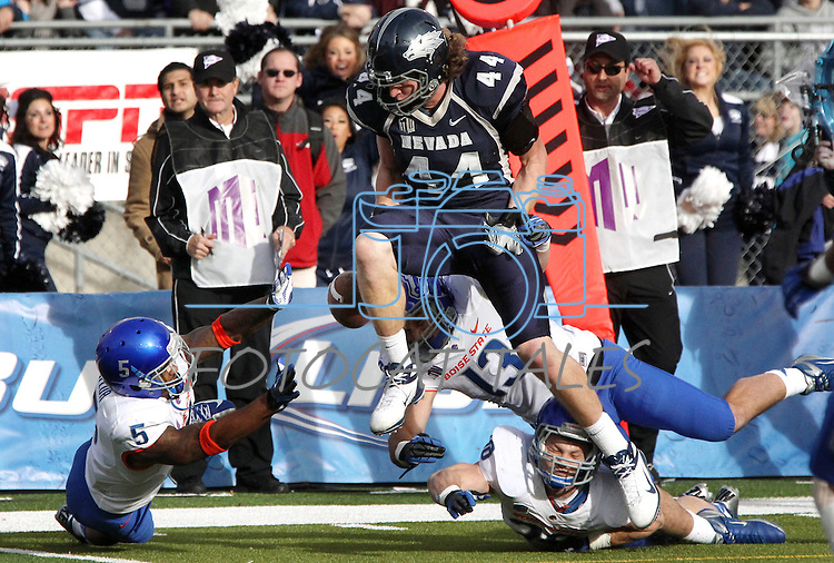 Nevada receiver Zach Sudfeld drops a pass near the goal line during the second half of an NCAA college football game on Saturday, Dec. 1, 2012,  in Reno, Nev. Boise State defenders Jamar Taylor (5), Blake Renaud (13) and Corey Bell (38) were in on the play. Boise State won 27-21. (AP Photo/Cathleen Allison)