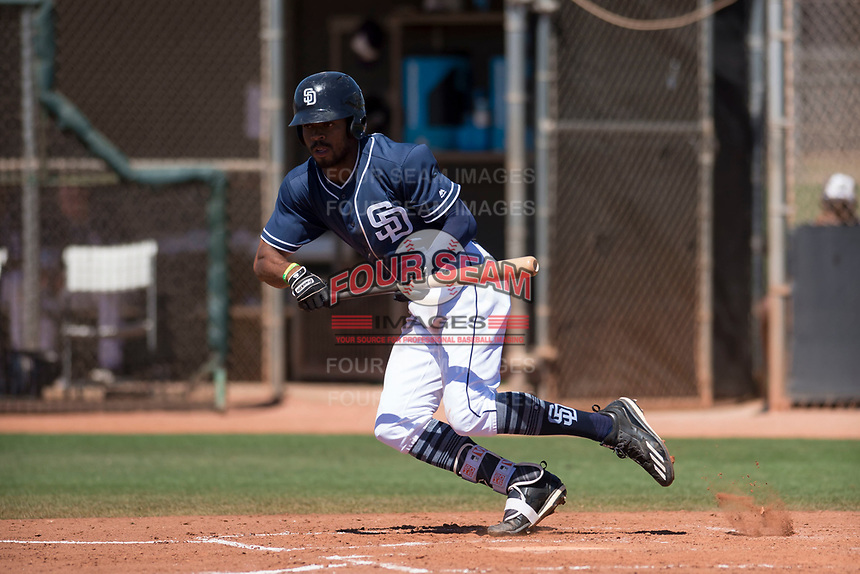 San Diego Padres left fielder Buddy Reed (56) starts down the first base line during an Extended Spring Training game against the Colorado Rockies at Peoria Sports Complex on March 30, 2018 in Peoria, Arizona. (Zachary Lucy/Four Seam Images)