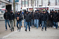 Thursday 20 February 2014<br /> Pictured: Napoli Supporters walk through Swansea City Centre, many covering their faces.<br /> Re: Napoli Supporters visit Swansea for tonights UEFA Leauge clash