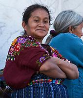 Chichicastenango, Guatemala.  Quiche (Kiche, K'iche') Woman on Steps of Santo Thomas Church, Sunday Morning.