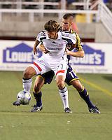 Chris Wingert (11) struggles against Wells Thompson (27) in the 1-2 RSL win at Rice Eccles Stadium in Salt Lake City, Utah on  June 21, 2008.