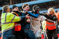 BIRMINGHAM, ENGLAND - MARCH 21:   Bafetimbi Gomis of Swansea City  celebrates his goal during the Barclays Premier League match between Aston Villa and Swansea City at Villa Park on March 21, 2015 in Birmingham, England. (Photo by Athena Pictures/Getty Images)