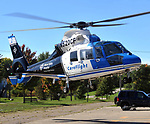 CareFlight lands at the Piqua Fire Department landing zone at the American Legion parking lot on October 12, 2013.