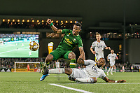 Portland, Oregon - Wednesday September 25, 2019: Jeremy Ebobisse #17 is tackled by Andrew Farrell #2 during a regular season game between Portland Timbers and New England Revolution at Providence Park on September 25, 2019 in Portland, Oregon.
