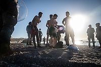 CEUTA, SPAIN ‐ MAY 19: A group of young migrants who have crossed the border between Spain and Morocco by swimming along the Tarajal beach, dry their clothes after being intercepted by the Spanish army to be returned to Morocco on May 19, 2021 in Ceuta, Spain.  After a diplomatic conflict between Spain and Morocco, thousands of migrants who have taken advantage of the little Moroccan police activity on the border to cross it mainly by swimming, which has caused a migration crisis with the entry of more than 8000 migrants from the African country. (Photo by Joan Amengual/VIEWpress )