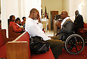 Donald Tucker wipes his eyes while Rev. Aldon Cotton preaches to his congregation about surviving day to day after Hurricane Katrina, Sun., Aug. 27, 2006.<br />(Cheryl Gerber for USA Today)