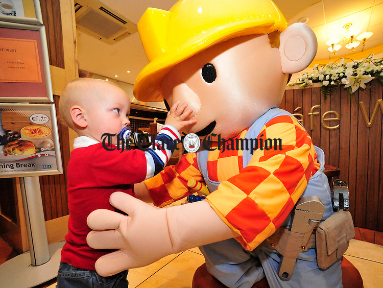 Paul Kelleher from Cork pictured with Bob the Builder who visited the West County Hotel on Wednesday. Photograph by Declan Monaghan