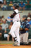 Arkansas Travelers outfielder Drew Maggi (9) at bat during a game against the Corpus Christi Hooks on May 29, 2015 at Dickey-Stephens Park in Little Rock, Arkansas.  Corpus Christi defeated Arkansas 4-0 in a rain shortened game.  (Mike Janes/Four Seam Images)
