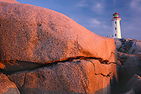 Granite boulders<br />   and Peggy's Point Lighthouse at sunset<br /> Peggy's Cove Preservation Area<br /> Nova Scotia,  Maritime Provinces,  Canada
