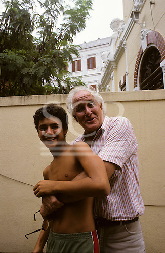 Rio de Janeiro, Brazil. Train robber Ronnie Biggs with his son Mike outside his home in Santa Tereza, 1988.