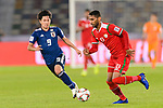 Khalid Al Braiki of Oman (R) is tackled by Minamino Takumi of Japan (L) during the AFC Asian Cup UAE 2019 Group F match between Oman (OMA) and Japan (JPN) at Zayed Sports City Stadium on 13 January 2019 in Abu Dhabi, United Arab Emirates. Photo by Marcio Rodrigo Machado / Power Sport Images
