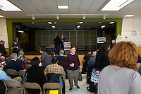 People gather before the Portland Democratic City Committee town caucus in the East End School cafeteria in Portland, Maine, USA, on March 3, 2014. Candidates presented their positions to the public and also gathered signatures required to get them listed on the ballot. The town caucus had speeches from various other local candidates and also served to choose delegates for the 2014 Maine State Democratic Caucus.