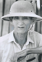1973 FILE PHOTO -<br /> <br /> <br /> The old and the young: Xom Suoi village; about 25 miles north of Saigon; was destroyed by the Viet Cong two weeks ago in a push to grab more territory to control under the ceasefire. An old man in a sun hat; a child; and a mother with a child appear to be wondering if the fragile truce deelared in Viet Nam will mean an end to a generation of war.