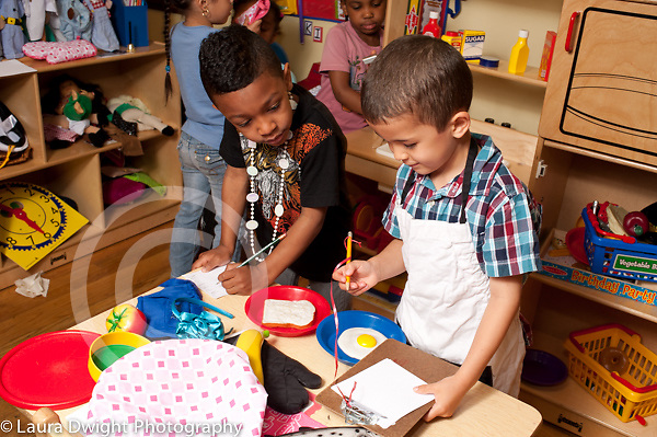 Education Preschool 4 year olds pretend play boys writing down orders for kitchen/chef job