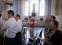 Tenth anniversary of 9/11.  Rebuilding at the World Trade Center site.  Sunday morning service at St. Paul's Chapel, across the street from Ground Zero.  Photo by Ari Mintz.  8/7/2011.