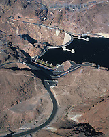 aerial photograph of Hoover Dam, Nevada, Lake Mead is full with water flowing down the spillway