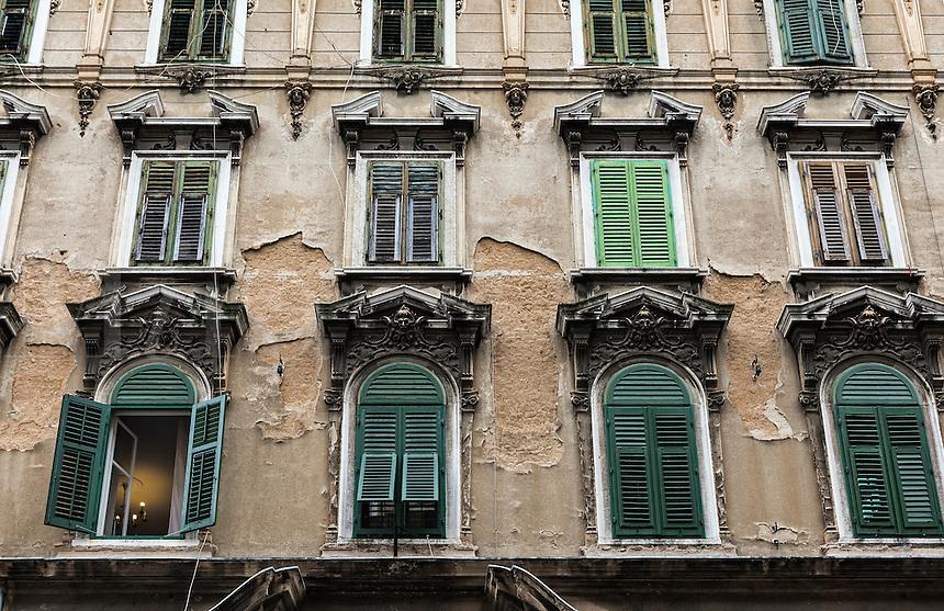 Building facade with shuttered windows, Rijeka, Croatia