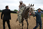 HOT SPRINGS, AR - APRIL 16: Jockey Ricardo Santana, Jr. gets a congratulations from trainer Ron Moquett after winning the Arkansas Derby at Oaklawn Park on April 16, 2016 in Hot Springs, Arkansas. (Photo by Justin Manning/Elipse Sportwire/Getty Images)