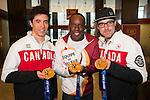 CIBC Team Next Mentor Bruny Surin is flanked by Canadian Paralympic Team members Gold Medallist Graham Nishikawa, and Robin Fémy, a Gold and double Bronze Medallist, at the CIBC Paralympian Welcome Home celebration in Montreal. / Bruny Surin, mentor de l'Équipe de relève CIBC, est entouré des membres de l'Équipe paralympique canadienne, Graham Nishikawa, médaillé d'or, et Robin Fémy, médaillé d'or et double médaillé de bronze, lors de la Fête CIBC pour accueillir les athlètes paralympiques à Montréal. Photo: Graham Hughes/CIBC