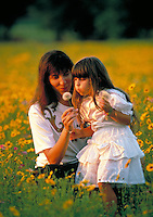 MOTHER AND 6 YEAR OLD GIRL BLOWING DANDELION  CHILD  CHILDREN PARENT WOMAN FLOWERING PLANTS  RELATIONS DEVELOPMENT QUIET MOMENTS. DAWN YANKEELOV, ANNMARIE CAMPBELL. OCALA FLORIDA.