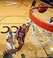 Nov 6, 2010; Charlottesville, VA, USA; Roanoke College g Melvin Felix (12) shoots the ball in front of Virginia Cavaliers g Jontel Evans (1) Saturday afternoon in exhibition action at John Paul Jones Arena. The Virginia men's basketball team recorded an 82-50 victory over Roanoke College.