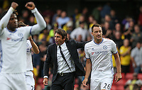 Chelsea Manager Antonio Conte is a happy man following a 100% premier league start as he walks off with John Terry of Chelsea  during the EPL - Premier League match between Watford and Chelsea at Vicarage Road, Watford, England on 20 August 2016. Photo by Andy Rowland.