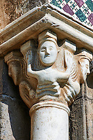 Romanesque sculpted Anthropomorphic capitals of the main portal of the 8th century Romanesque Basilica church of St Peters, Tuscania, Lazio, Italy