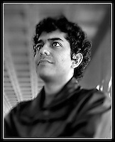 Joey Castillo poses for a portrait taken with a 4x5 large format camera outside the Communications Building on campus at the University of Texas on November 21, 2006. (Brian Ray)
