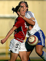 Ferreiras, PORTUGAL: Lindsay Tarpley is stoped by Finland player at the Nora Stadium in Ferreiras, March 09 of 2007, during the Algarve Women´s Cup soccer match between USA and Finland. USA won 1-0. Paulo Cordeiro/International Sports Image