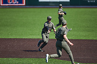 Dominic Keegan (12) of the Vanderbilt Commodores flips the ball to pitcher Ethan Smith (27) as he covers first base during the game against the South Carolina Gamecocks at Hawkins Field on March 21, 2021 in Nashville, Tennessee. (Brian Westerholt/Four Seam Images)