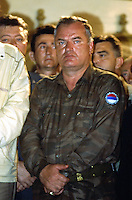 """Yougoslavia. Bosnia. Serbian republic. Bijelina. Ratko Mladic. Celebration for """"Vidovdan"""" day. Each year on the 28th of June, the serbs celebrate the day of the army. Religious service in the orthodox church. General Ratko Mladic is on the list of the International Criminal Tribunal for the former Yugoslavia (ICTY), based in The Hague in the Nederlands, as a most wanted man for war crimes. © 1995 Didier Ruef"""