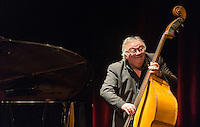 Gilles Chevaucherie at a concert of music by Sidney Bechet at the Théatre des Bouffes Parisiens at 4 Rue Monsigny, 75002 Paris by the Daniel-Sidney Bechet Quintet including Olivier Franc (Saxophone), Daniel-Sidney Bechet (Drums / Batterie), Jean-Baptiste Franc (piano), Benoit de Flamesnil (trombone), and Gilles Chevaucherie (Double Bass / Contrebasse). Daniel-Sidney Bechet is the son of Sidney Bechet and Jean Baptiste is the son of Olivier Franc who plays on the soprano saxophone that belonged to Sidney Bechet. Olivier Franc is regarded worldwide as being the best interpreter of Sidney Bechet's music. Sidney Bechet was born in New Orleans in 1897. He first performed as a clarinettist at the age of 15 with the Eagle Band and soon teamed up with Louis Armstrong. He travelled to London in 1919 and then to Paris where he then spent most of his life up until his death on his sixty second birthday in 1959. He is regarded as one of the pionniers of jazz, and was the first soloist to be recorded.  Duke Ellington considered him the greatest soloist and creator of jazz throughout the history of jazz. The Quintet have won many awards, and Jean-Baptiste Franc is also a regular piano player at Paris Boogie Speakeasy, the private jazz club founded by Yves Riquet in Paris. Sunday 23rd February 2014.