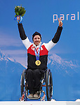 Sochi, Russia.15/03/2014- Canadian Josh Dueck celebrates his gold medal in the mens super combined sit skiing during the 2014 Paralympic Games in Sochi Russia.Photo(Scott Grant/Canadian Paralympic Committee