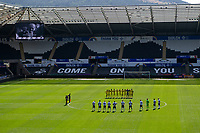 Players from both sides take part in a minute silence during the Sky Bet Championship match Swansea City and Wycombe Wanderers at Liberty Stadium in Swansea, Wales. Sporting stadiums around the UK remain under strict restrictions due to the Coronavirus Pandemic as Government social distancing laws prohibit fans inside venues resulting in games being played behind closed doors.<br /> Saturday 17 April 2021