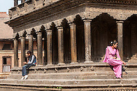 Nepal, Patan.  Two Young Nepalese Women, one in Western Clothing, one in Traditional.