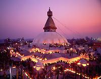 Nepal, Kathmandu. Boudhanath Stupa. 100,000 butterlamps lit for the passing of a high Tibetan Lama.