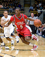 11 November 2009:  Donavan Foster of Detroit dribbles the ball away from California defender during the game at Haas Pavilion in Berkeley, California.   California defeated Detroit, 95-61.