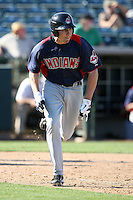 Matt McBride of the Cleveland Indians bats against the Oakland Athletics in a spring training game at Phoenix Municipal Stadium on March 2, 2011  in Phoenix, Arizona. .Photo by:  Bill Mitchell/Four Seam Images.