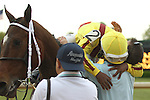 HOT SPRINGS, AR - APRIL 9: Jockey Ricardo Santana, Jr. aboard Terra Promessa #2, being congratulated by assistant trainer Darren Fleming, after winning the Fantasy Stakes at Oaklawn Park on April 9, 2016 in Hot Springs, Arkansas. (Photo by Justin Manning/Elipse Sportwire/Getty Images)